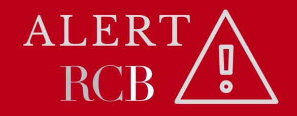 zdjęcie kolorowe: na czerwonym tle biały napsi o treści ALERT RCB i trójkat w środku którego jest znak wykrzyknika